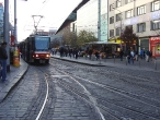 70-prague-trams-on-stop-and-metro-station-andel-on-plzenska-street-29-11-2009